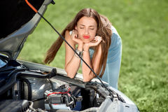 sad-woman-near-broken-car-waits-assistance-her-down-road-side-44115208